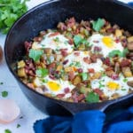 One pan breakfast recipe is served out of a cast-iron skillet.