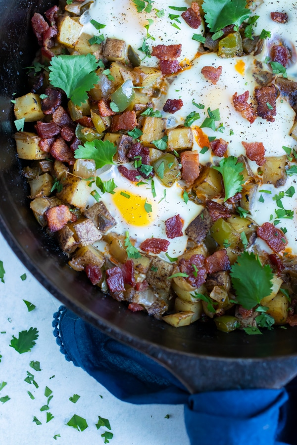 Hash and eggs skillet recipe is served for a family friendly breakfast recipe.