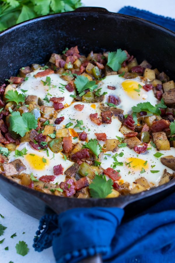Breakfast hash and egg is set on the counter for a dairy-free recipe.