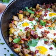 Potato hash and eggs are cooked in one pot for an easy recipe.