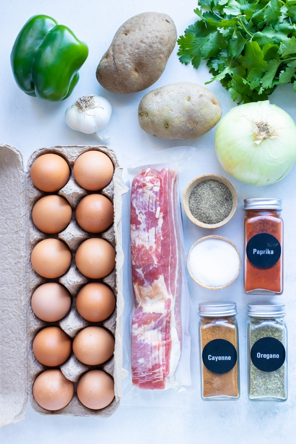 Eggs, bacon, seasonings, potatoes, and vegetables are the ingredients needed for this recipe.