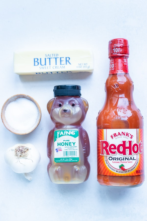 Butter, Frank's Red Hot sauce, honey, garlic, and salt are the ingredients used for this homemade buffalo sauce recipe.