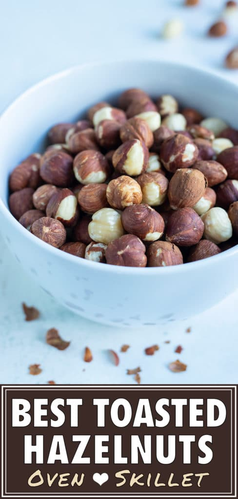 A bowl of toasted hazelnuts is set on the counter for snacking.