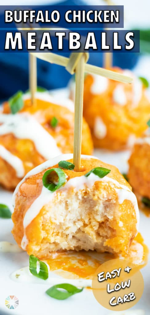A close-up of a buffalo chicken meatballs with a bite taken out.