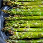 Crispy asparagus stalks are cooked in an air fryer for a healthy side.