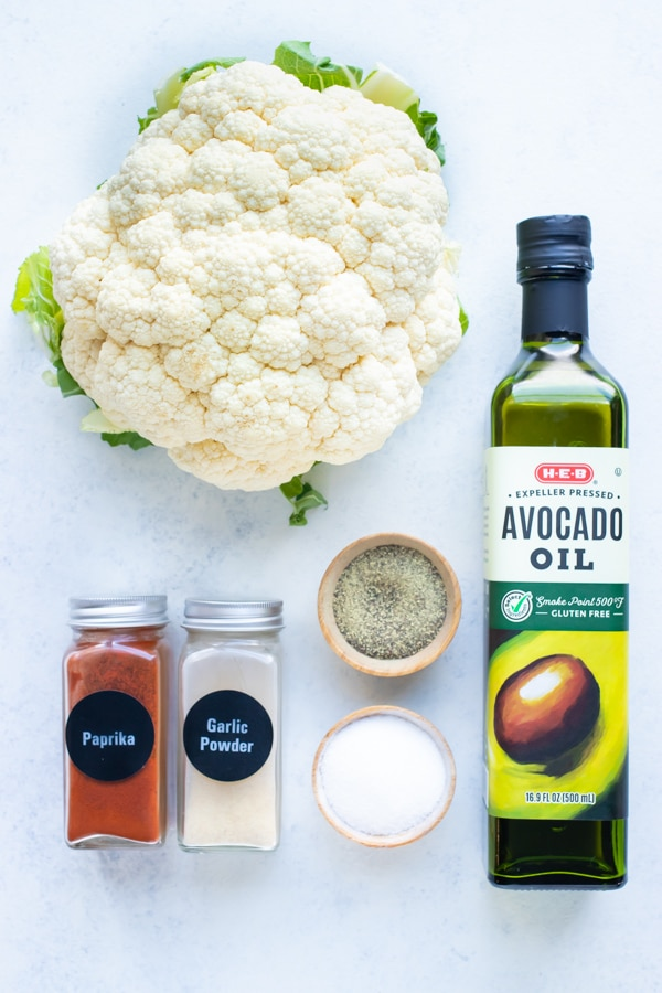 Avocado oil, cauliflower, and seasonings are the ingredients needed for this air fryer cauliflower recipe.