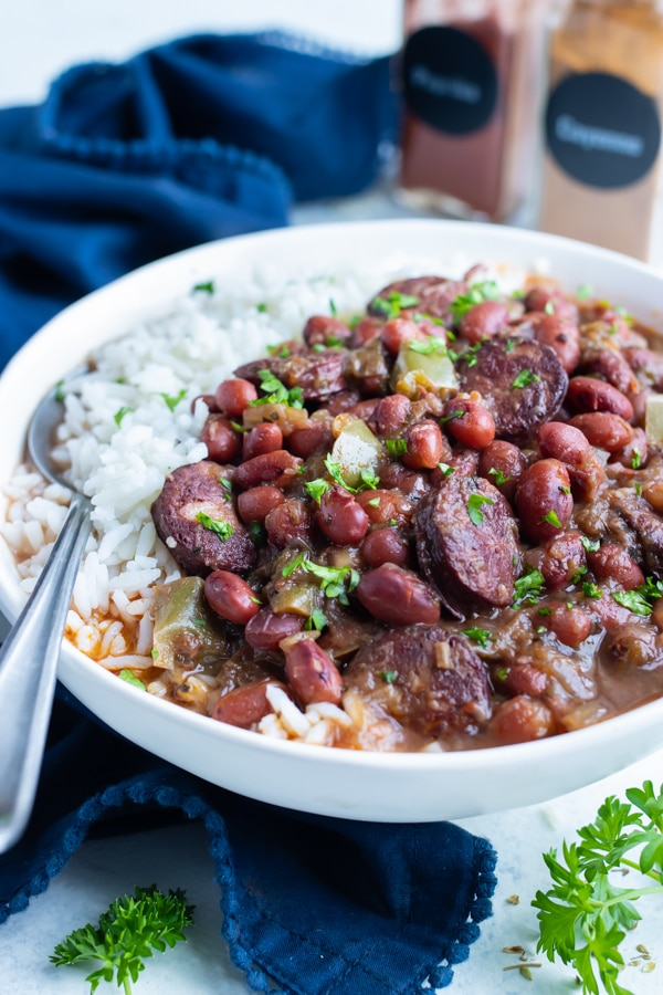 Instant pot red beans and sausage are served with white rice.