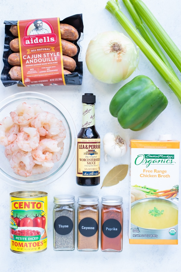 Shrimp, sausage, tomatoes, cajun spices, celery, onion, peppers, roux, and Worcestershire Sauce are the ingredients needed.