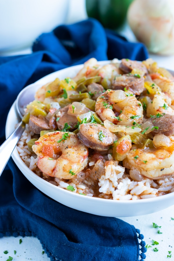 Gumbo made from scratch is placed with rice in a white bowl.