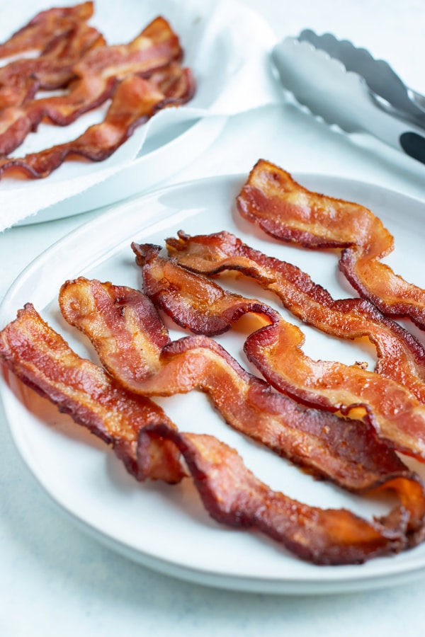 Extra crispy bacon is served on a plate.
