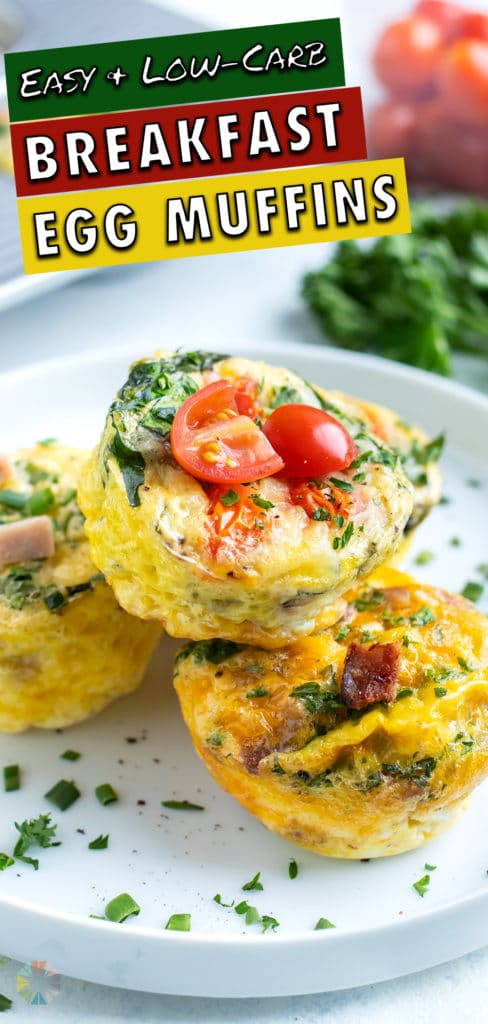 Keto egg cups are served on a plate with fresh herbs.