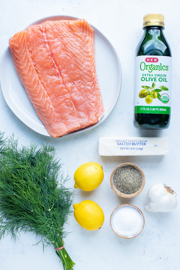 Oil, butter, lemon, fresh dill, garlic, salmon, salt, and pepper are the ingredients in this recipe.