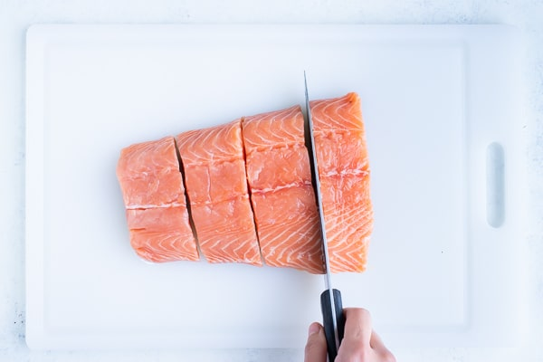 One pound of salmon is cut into four pieces.