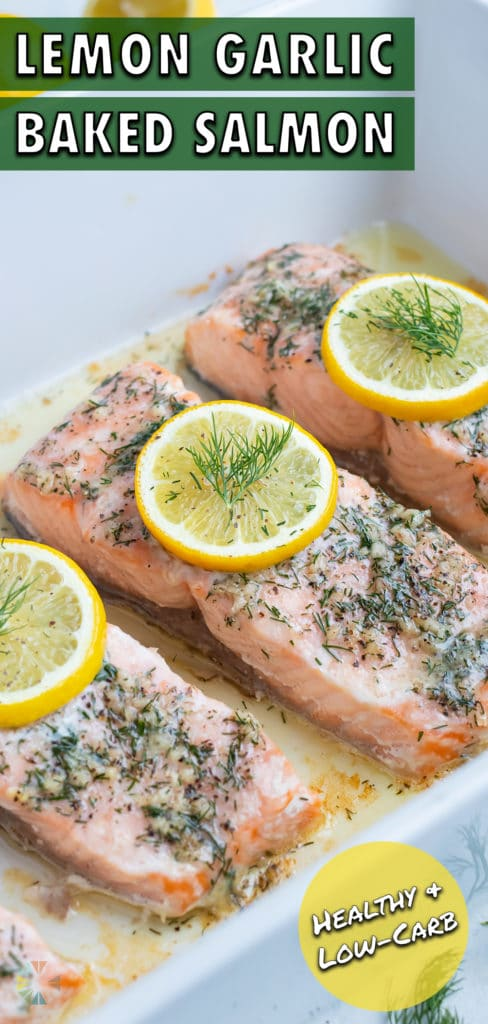 Dill and lemon is placed on top of baked salmon.
