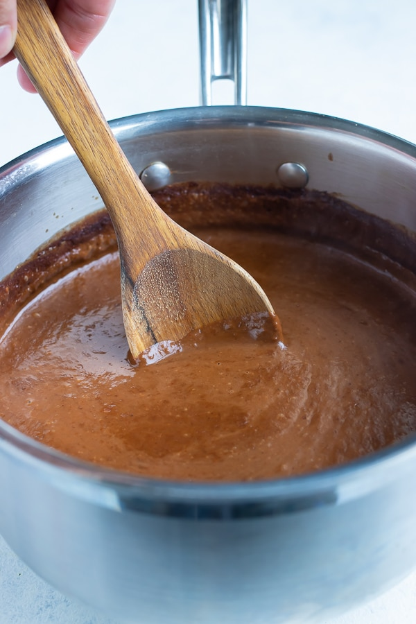Mole sauce is simmering for 15 minutes on the stove.