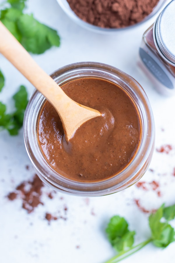 Easy to make mole sauce is shown in a jar on the counter.