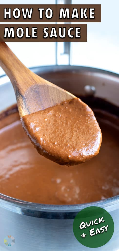 A wooden spoon is used to stir and dish authentic mole sauce.