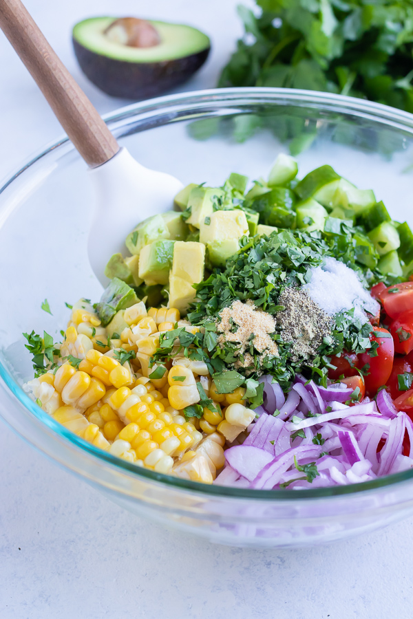 All the ingredients are combined in a glass bowl.