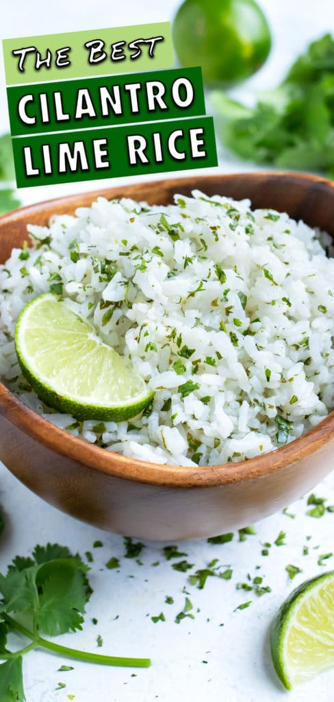 This easy cilantro lime rice recipe is served in a wooden bowl with fresh lime.