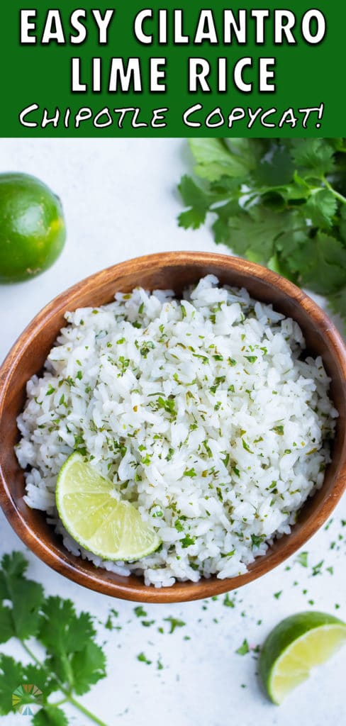 Fresh cilantro and a lime wedge is served with a bowl of cilantro rice.