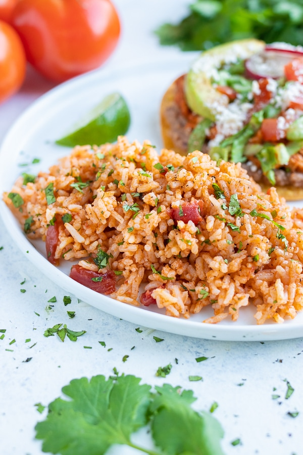Easy Mexican rice is served as a side dish on a plate.
