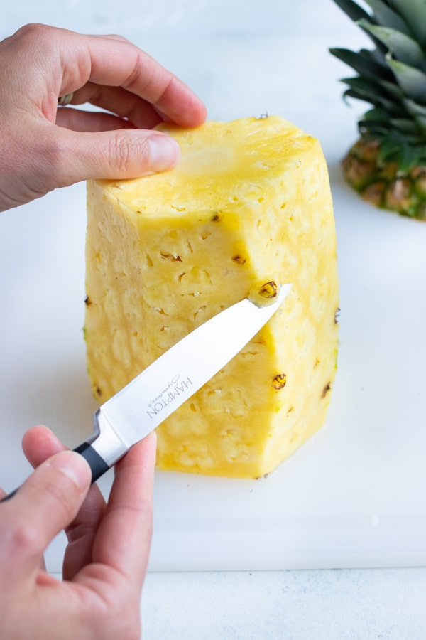 A knife is used to cut off any remaining skin or dark eyes.