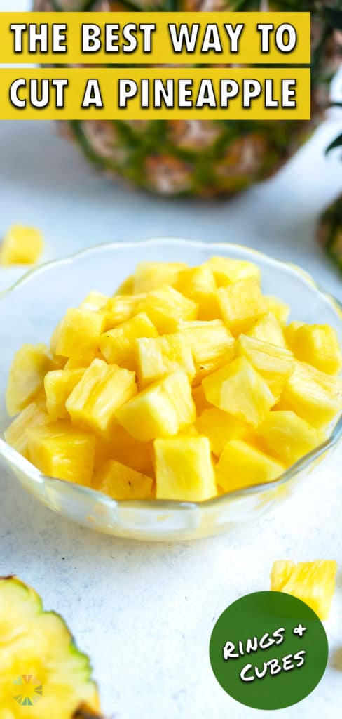 A bowl of pineapple cubes are set on the counter.