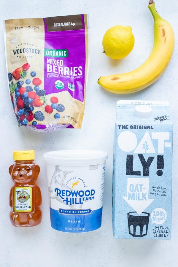 Mixed berries, banana, lemon, yogurt, oat milk, and honey are the ingredients in this smoothie.