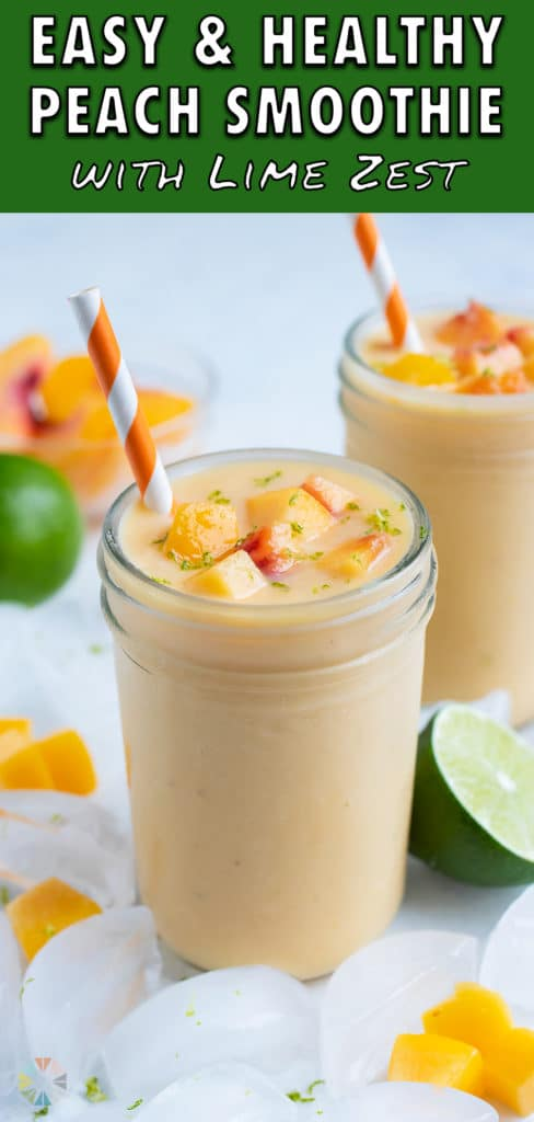 Thick and creamy peach shake is served in a glass cup with a straw.