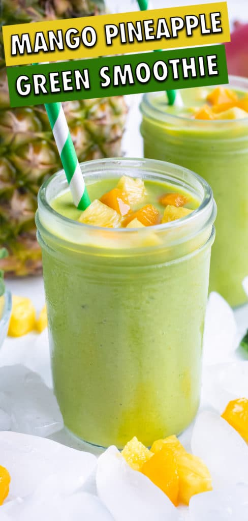 Two glasses are filled with a pineapple spinach smoothie.