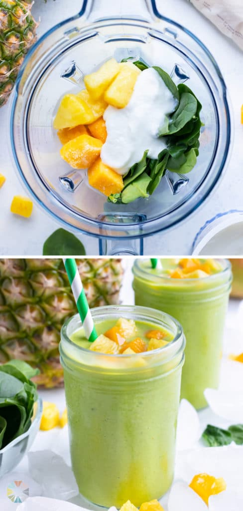 The two tropical green smoothies are topped with mango and pineapple chunks.