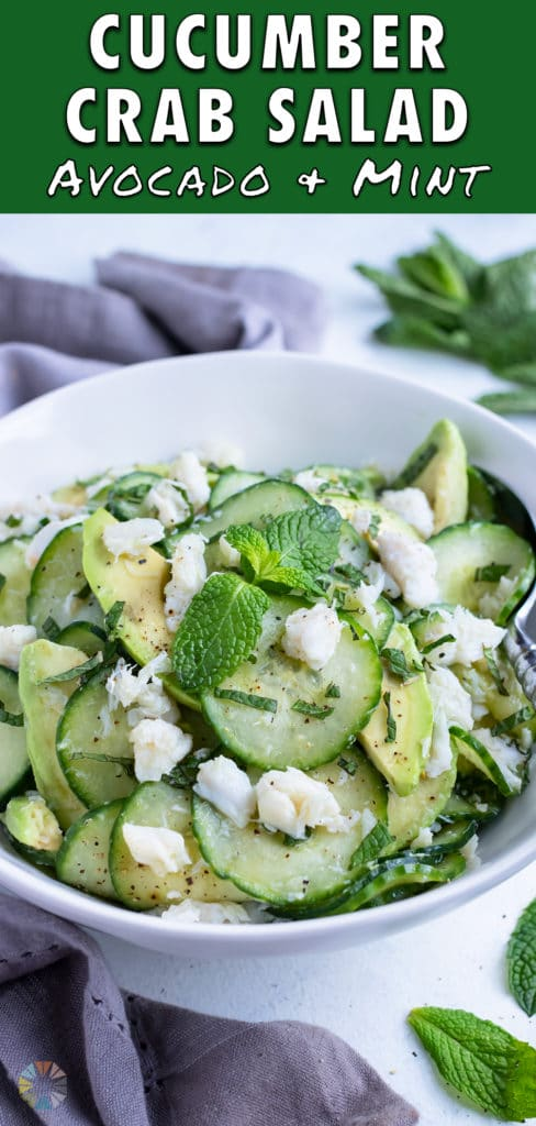 The Cucumber Crab Salad is served in a white bowl with a metal spoon.