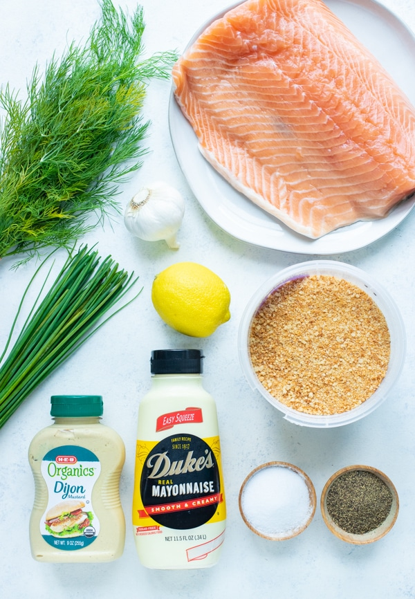 Mayonnaise, salmon, dill, salt, pepper, breadcrumbs, chives, mustard, and lemon juice are the ingredients used.