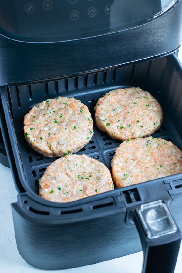 The four burgers are cooked in the air fryer.
