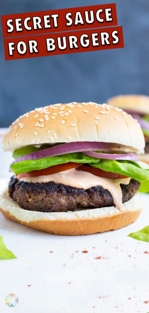 The hamburger is spread with the homemade secret sauce.