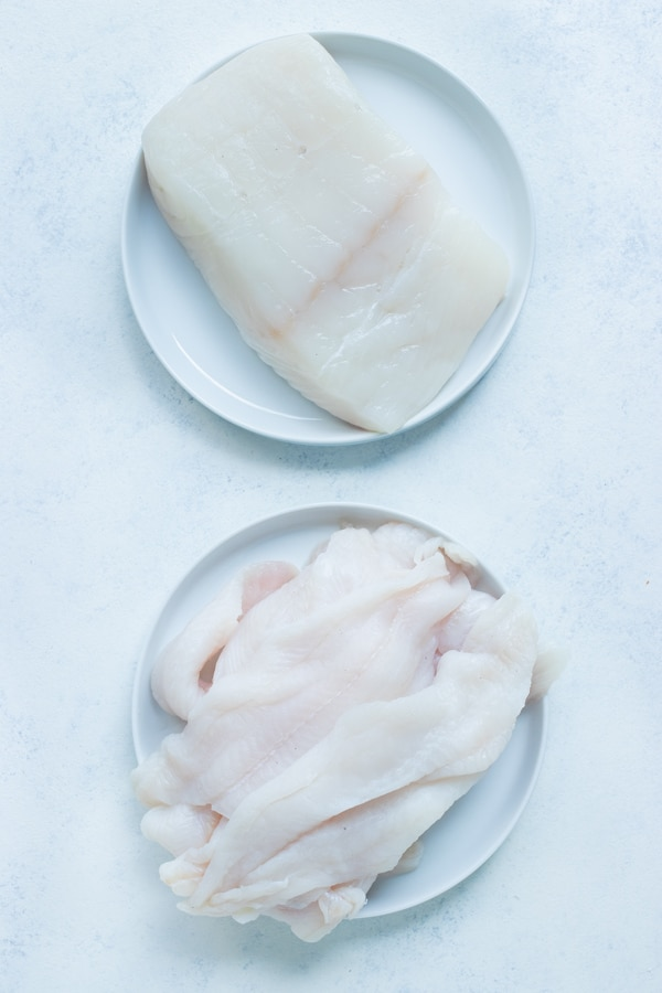 Cod fillets and other types of white fish are shown for this recipe.