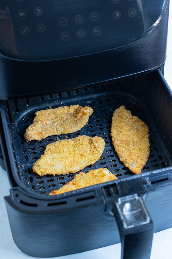 The fish is air fried until golden brown and crispy.