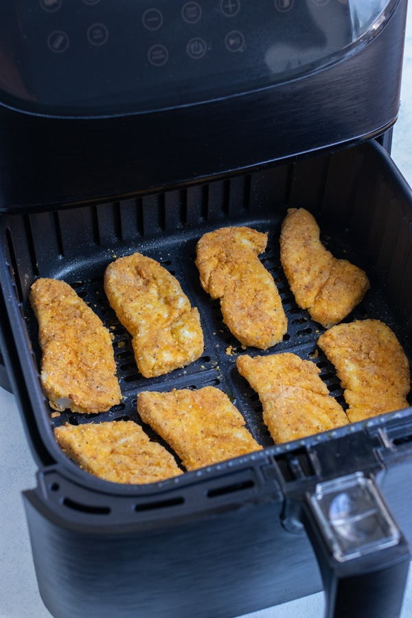 The fish is cooked in the air fryer until crispy.