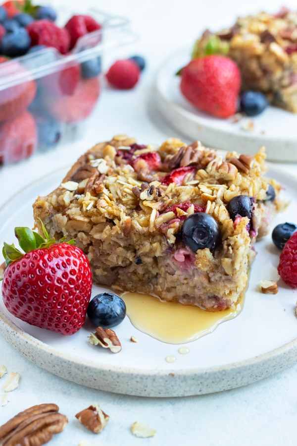 Berries are served with this healthy baked oatmeal.