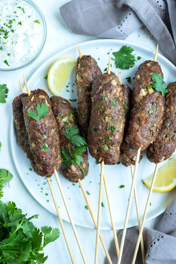 The Lamb Kofta is plated for a Greek dinner recipe.