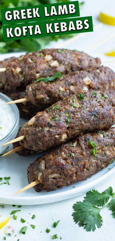 Lamb Kofta is served on a white plate with Tzatziki sauce.
