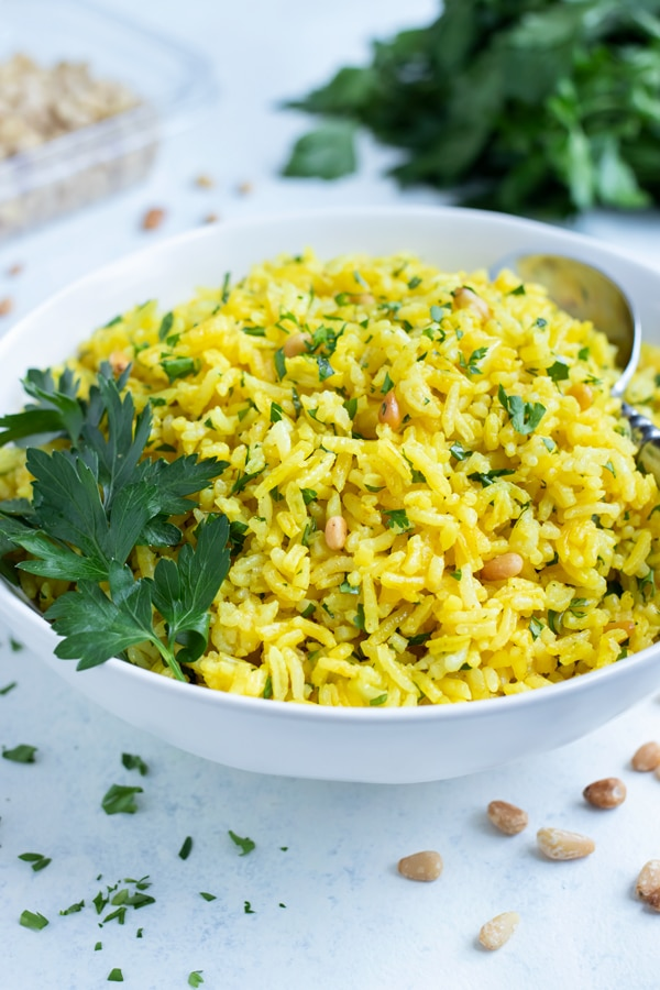 Gluten-free yellow rice is served for a Mediterranean meal.
