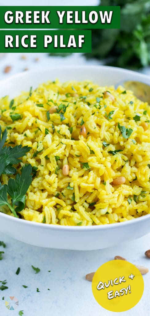 A close up picture shows the fresh herbs and nuts in the Mediterranean Yellow Rice.