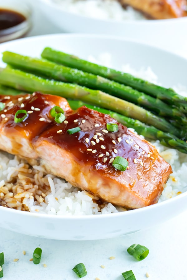 Tender and flaky salmon is served with a homemade teriyaki sauce and rice.