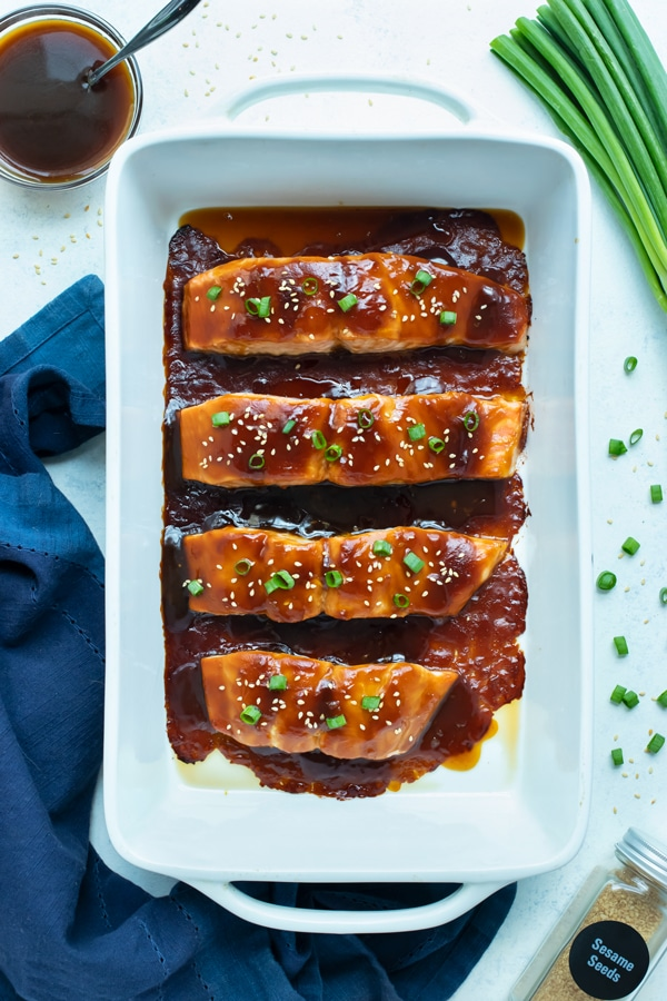 An overhead shot is shown with baked salmon covered in a homemade teriyaki sauce.
