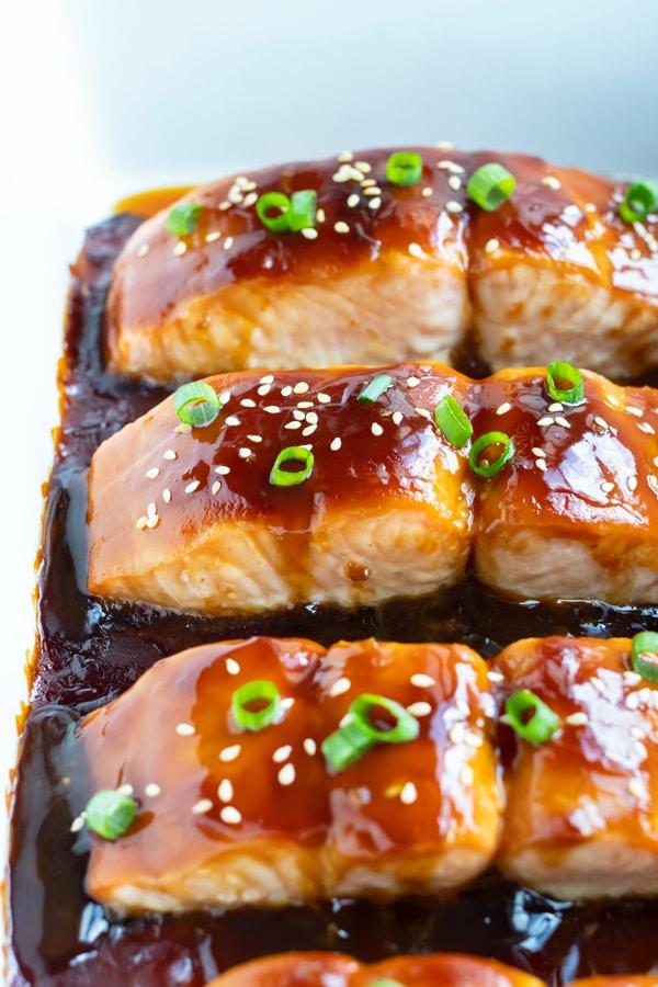 Sticky and sweet teriyaki salmon is baked until tender.