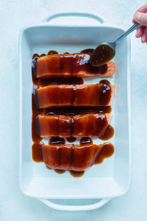 The salmon is covered with the teriyaki sauce.