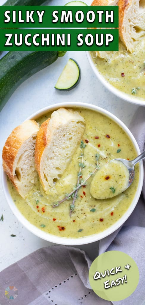 A bowl of zucchini soup is enjoyed with bread.