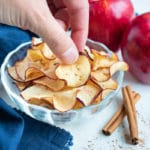 Easy-to-make Apple Chips are served in a bowl for a healthy, sweet snack.