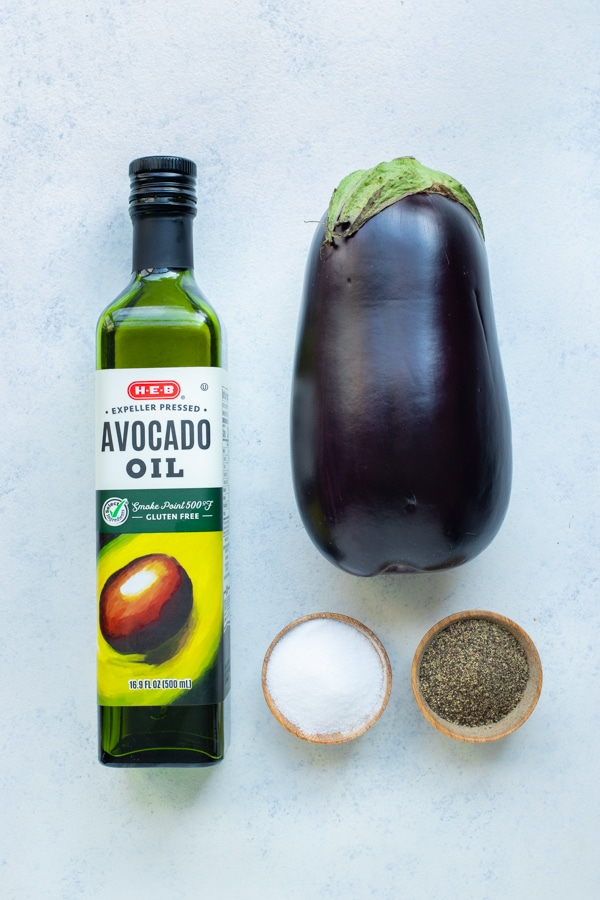 Raw eggplant, olive oil, salt, and pepper are the ingredients for this recipe.